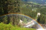 Krimml_Waterfall_113_07142018 - Looking down at a big bold full arc rainbow coming from the mist of the second Krimml Waterfall
