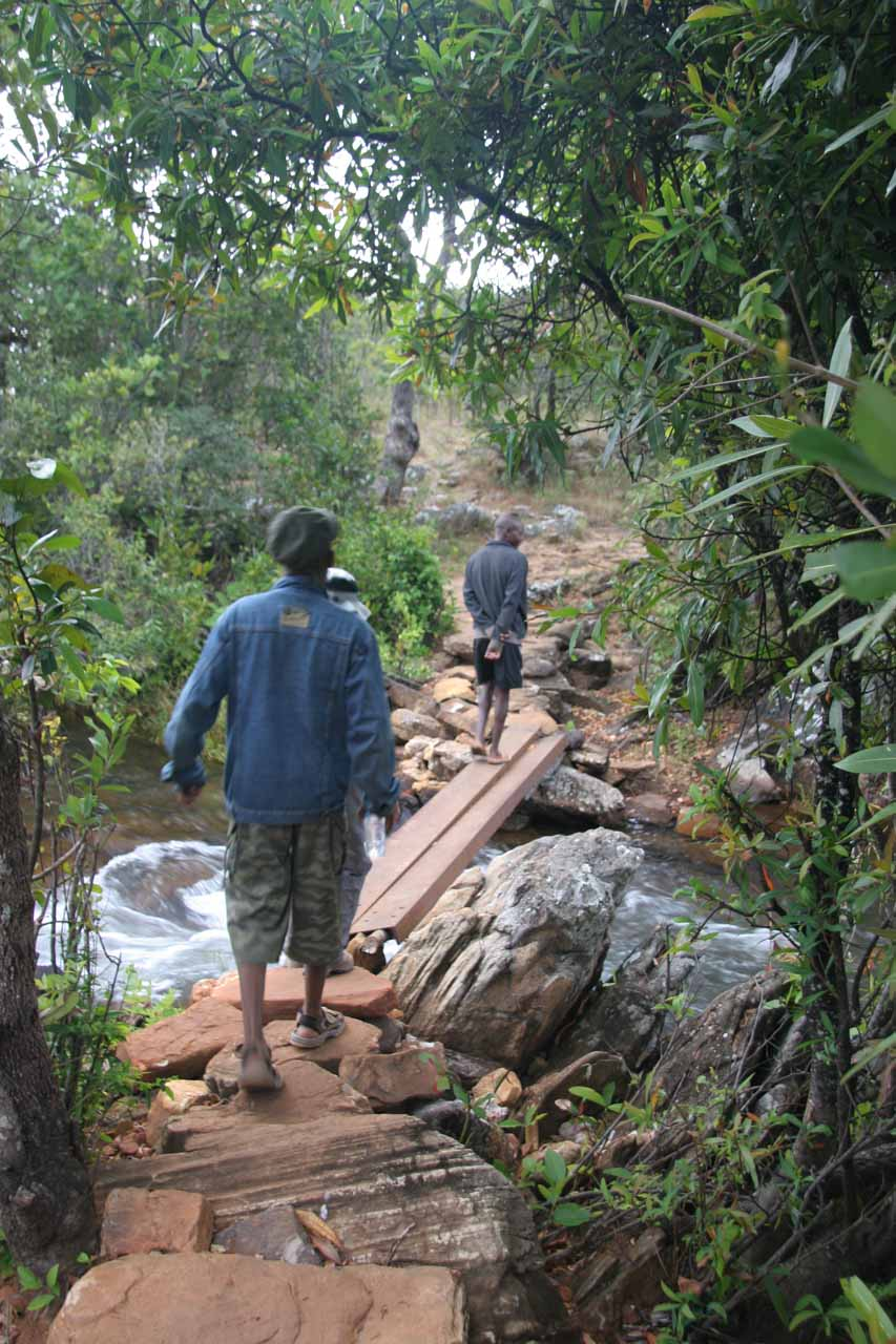 Following the guides over a stream as we continued walking to Kundalila Falls