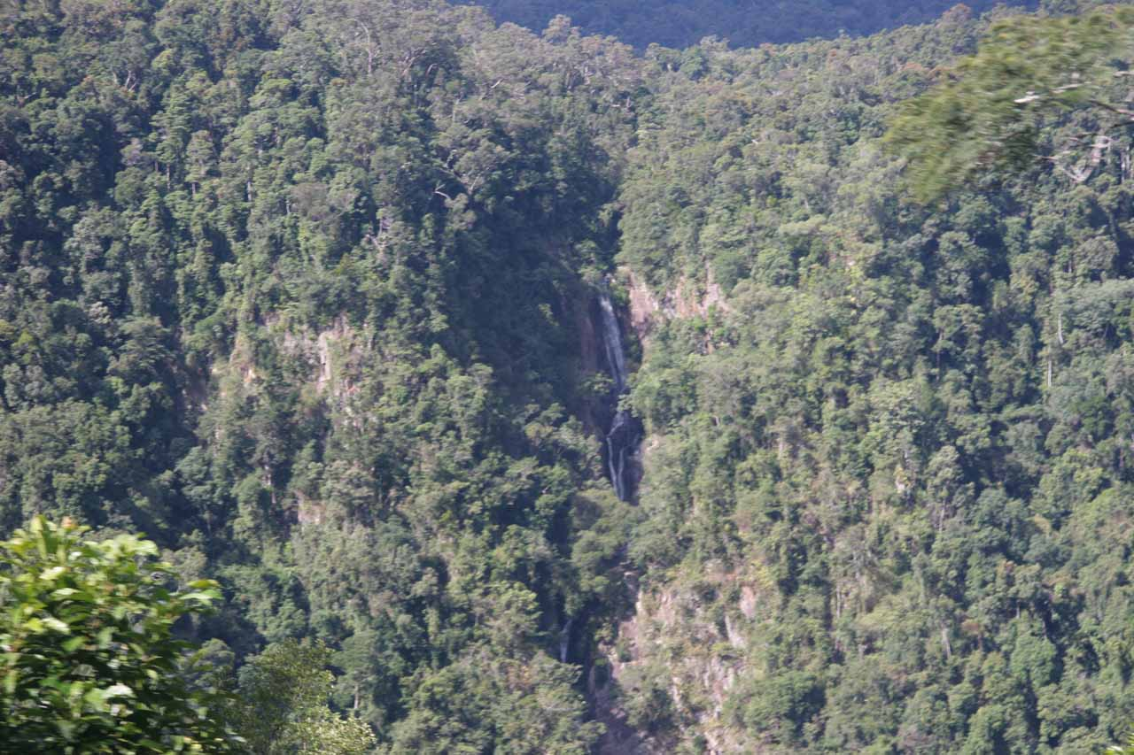 Distant view of some waterfall seen along the railway after passing by Barron Falls