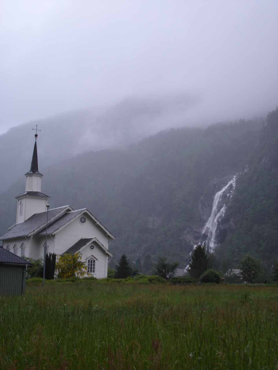 Church fronting a partial view of Kvernhusfossen