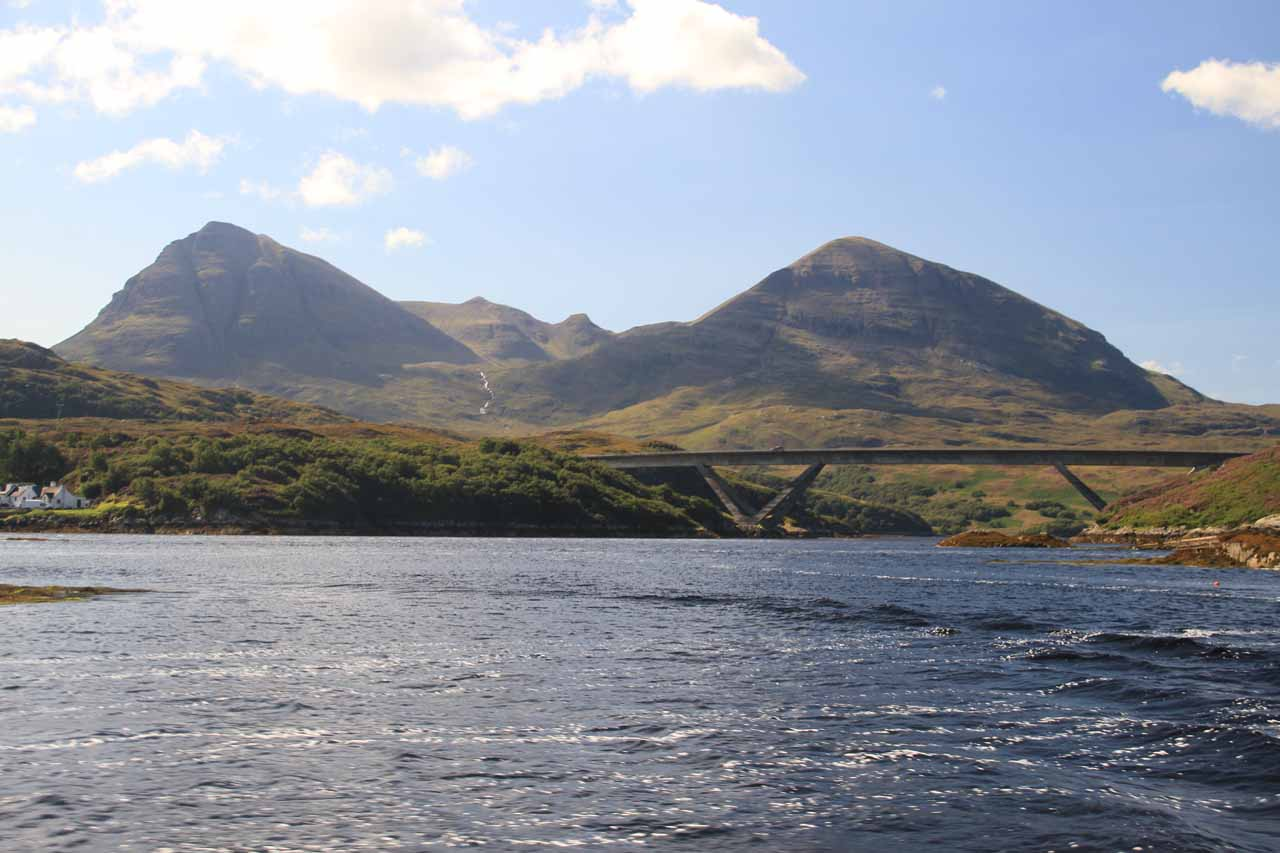 Looking back towards a bridge and mountains backing Kylesku.  Notice the cascade tumbling beneath the mountains