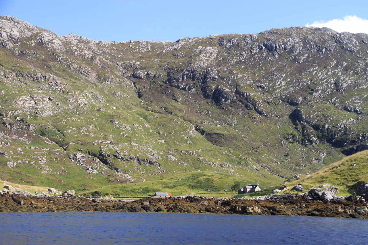 A house said to be abandoned was situated on the shores of Loch Beag dwarfed by mountains behind it