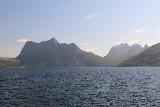 Kystriksveien_055_07082019 - Looking east towards the shapely mountains during the ferry crossing between Skarberget and Skognes