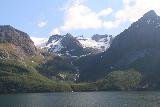 Kystriksveien_242_07082019 - Another look across Glomfjorden towards some impressive waterfalls and glacier arms beneath Svartisen