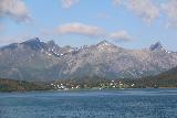 Kystriksveien_392_07082019 - Looking towards a hamlet fronting some sharp peaks while on the Arhaugfjorden ferry