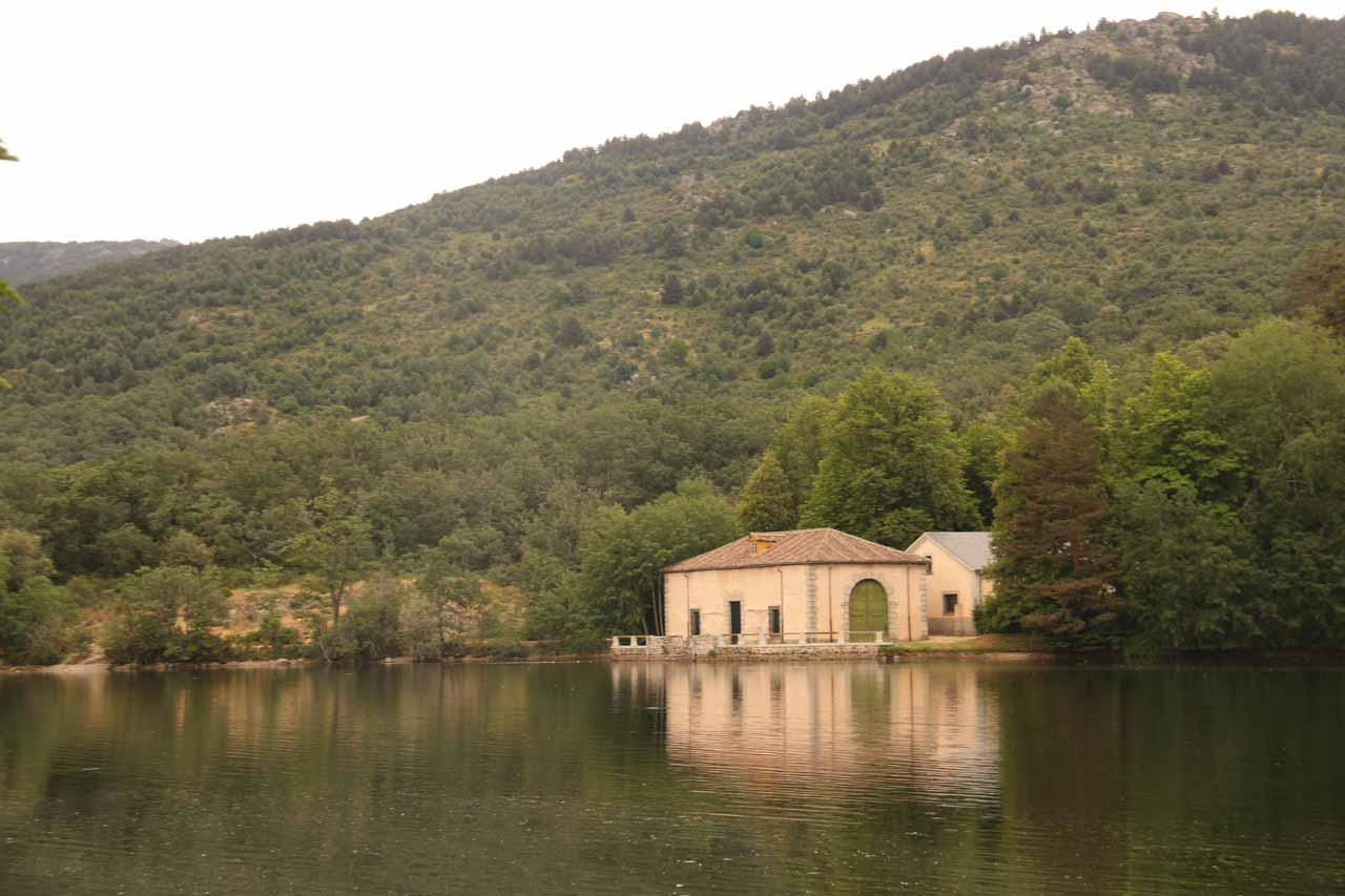 Looking across the man-made lake towards some kind of hydro facility within the extensive gardens of La Granja