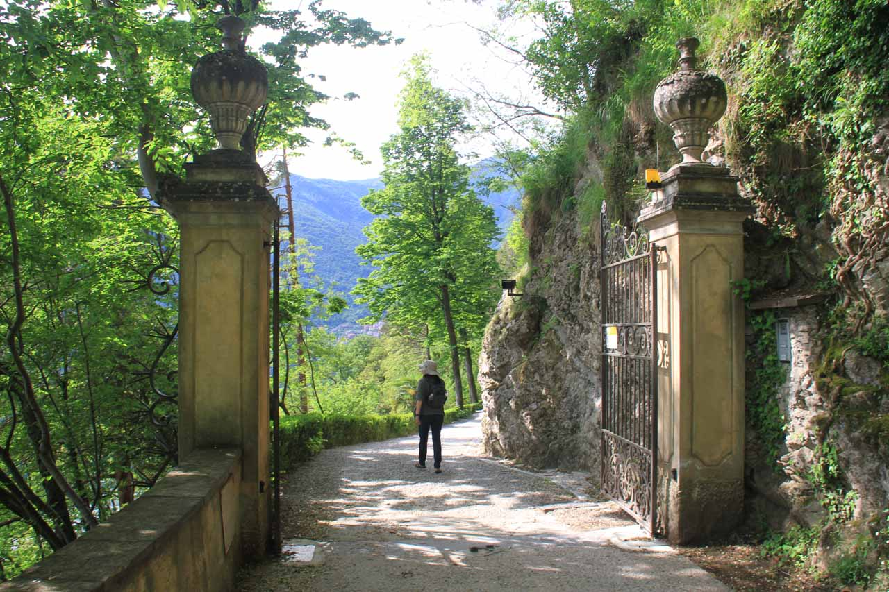 Julie going past another of the gates to Villa Balbianello