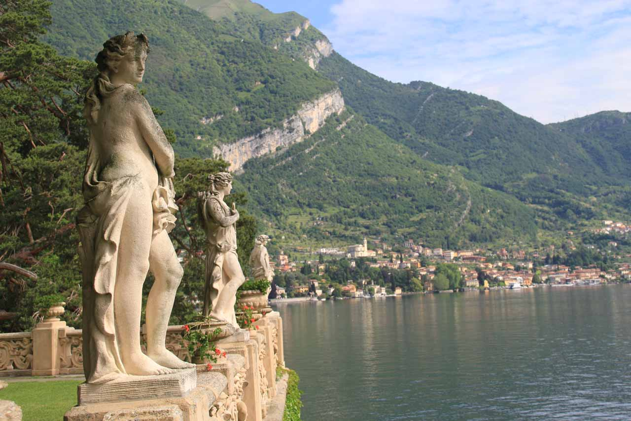 Statues lined up along the fancy railing facing Lago di Como