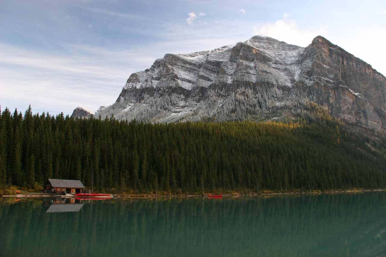 Looking towards a boat house with reflections in Lake Louise