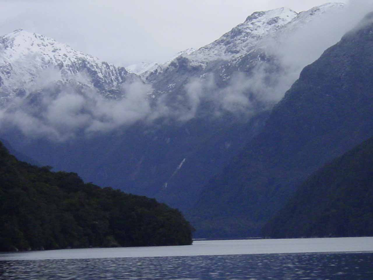 Looking in the distance towards some thin cascade off in the distance while on Lake Manapouri