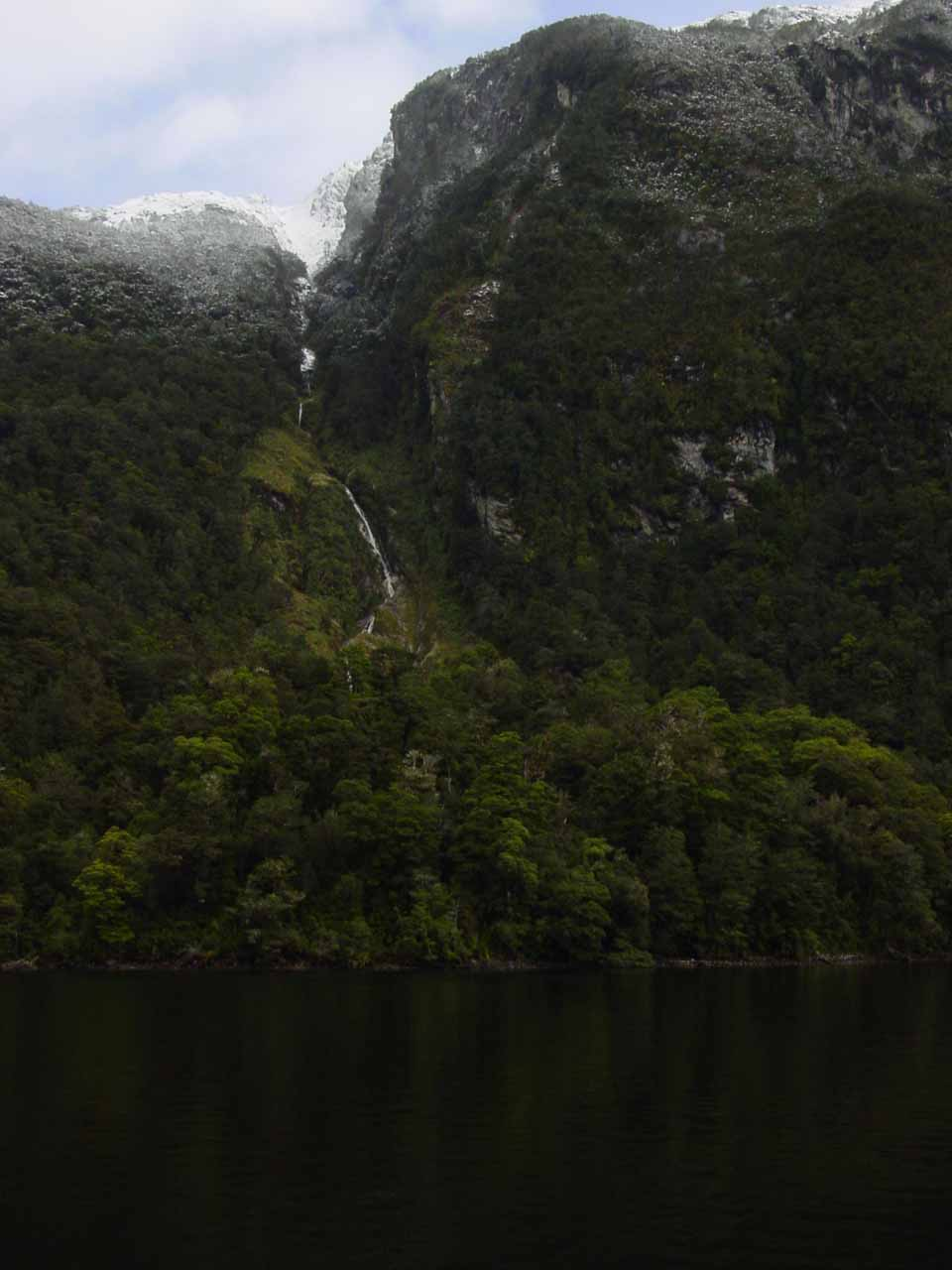 Looking towards some unnamed ephemeral waterfall spilling into Lake Manapouri
