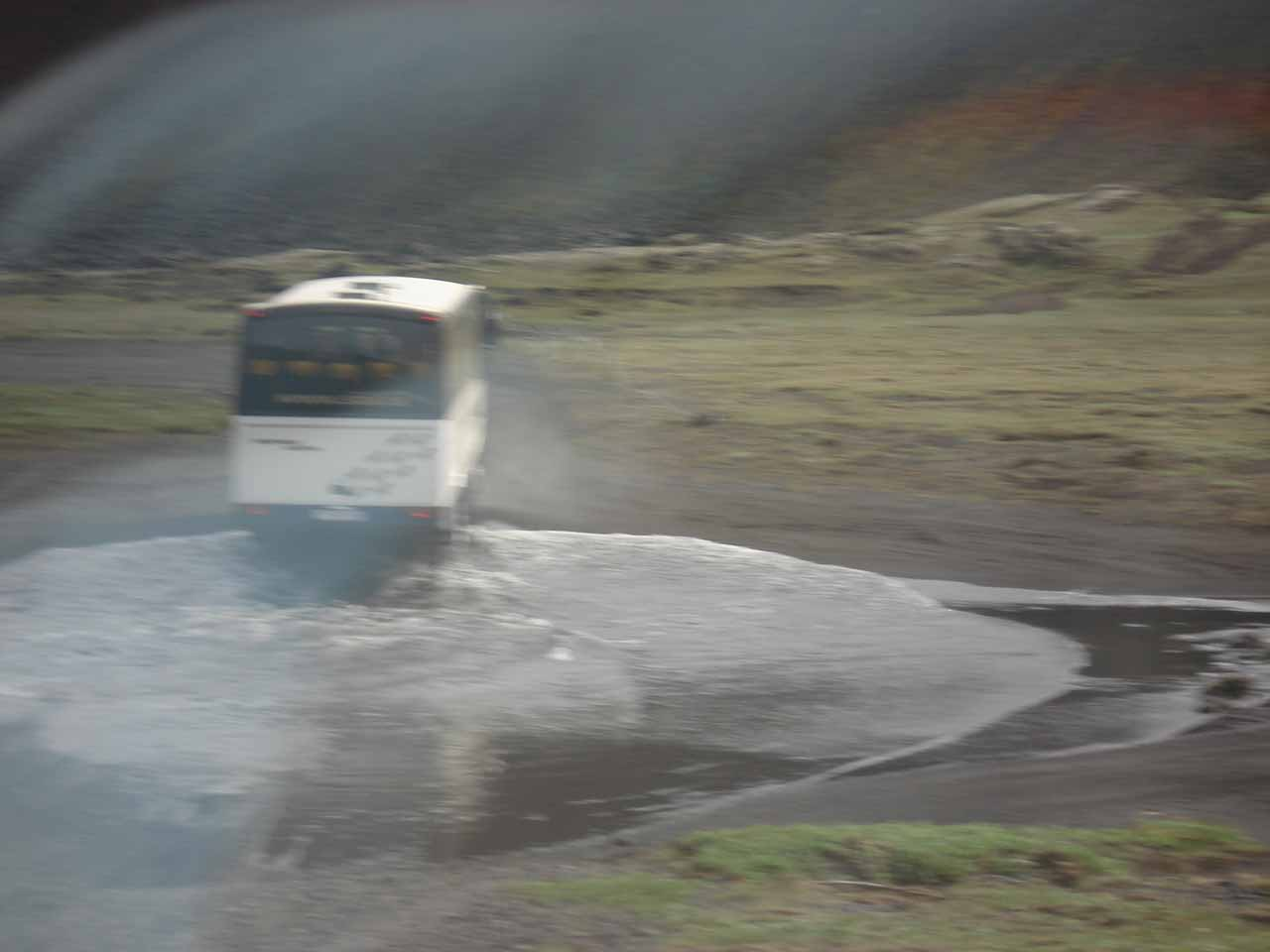 I kept this blurry shot just to show you that these buses are capable of completing an unbridged river crossing