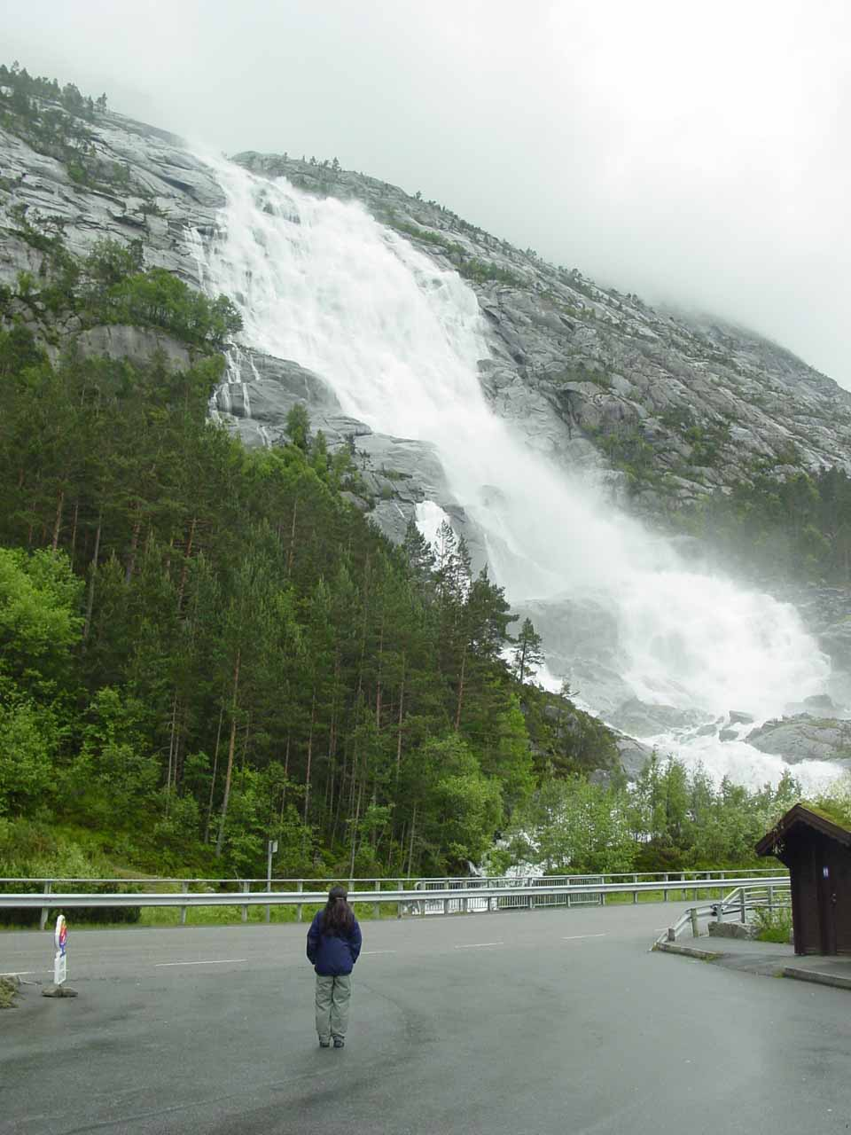 Julie checking out Langfoss from the car park near its base