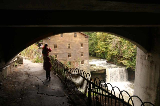 Lanternmans_Falls_029_10042015 - Context of Julie and Tahia going underneath the Canfield Road Bridge with the Lanterman's Falls and Lanterman's Mill already visible