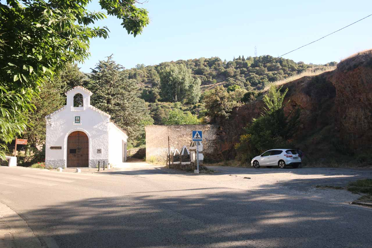 Looking back at the parked car and the church by Fuente Agria