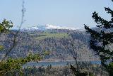 Latourell_Falls_182_04062021 - Looking across the Columbia River and state border towards some snow-capped mountains within the Gifford Pinchot National Forest from the Upper Latourell Falls Trail