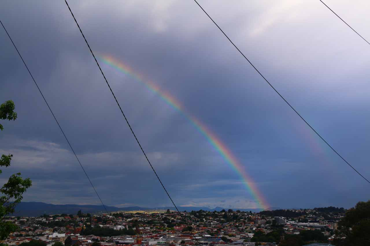 Broad half-rainbow over the city of Launceston as there was an incoming storm