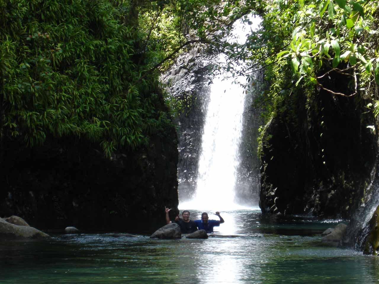 Our guide Augustino and I swimming in front of Wainibau Falls