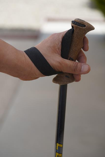 After putting my hand through the bottom of the wrist strap's loop, I can then lightly grip the pole with the bottom of my palm resting on the wrist strap itself