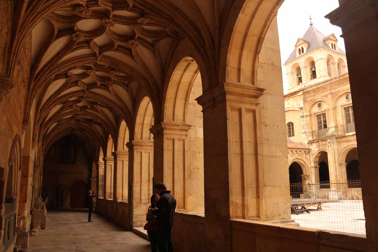 Looking along the arched walkway flanking the courtyard in the Basilica de San Isidro in Leon