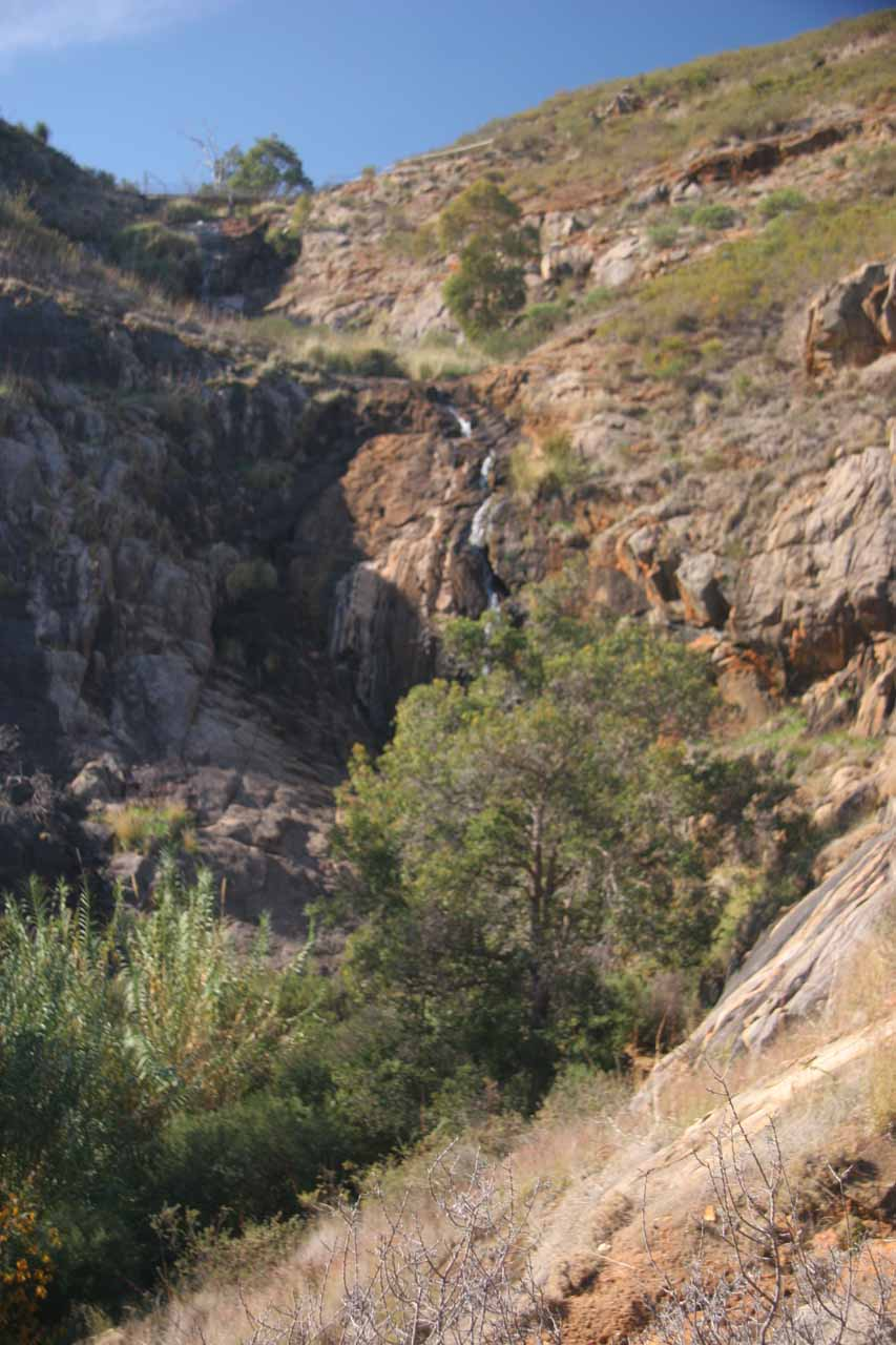 Looking up at the struggling Lesmurdie Falls from its base