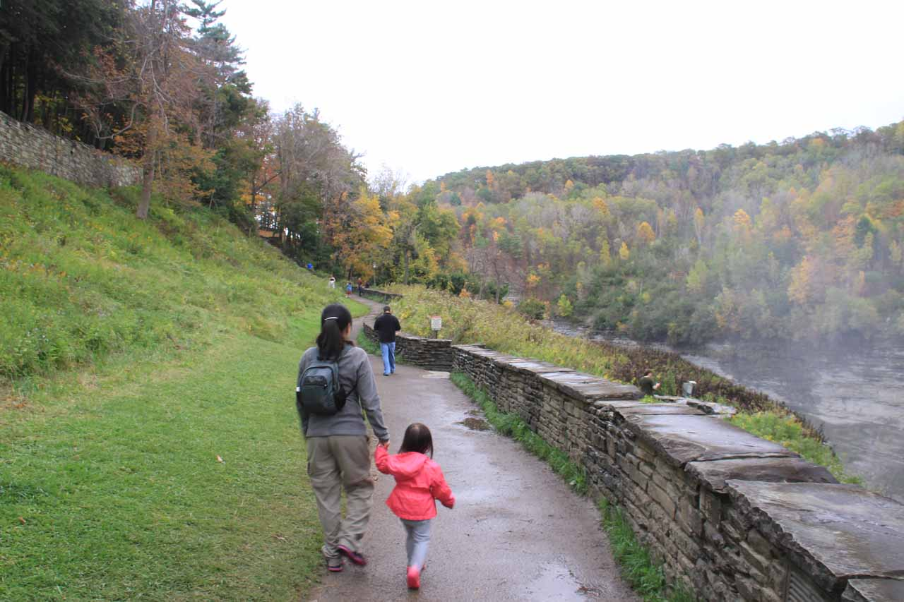 Julie and Tahia walking near the Middle Falls of the Genesee River