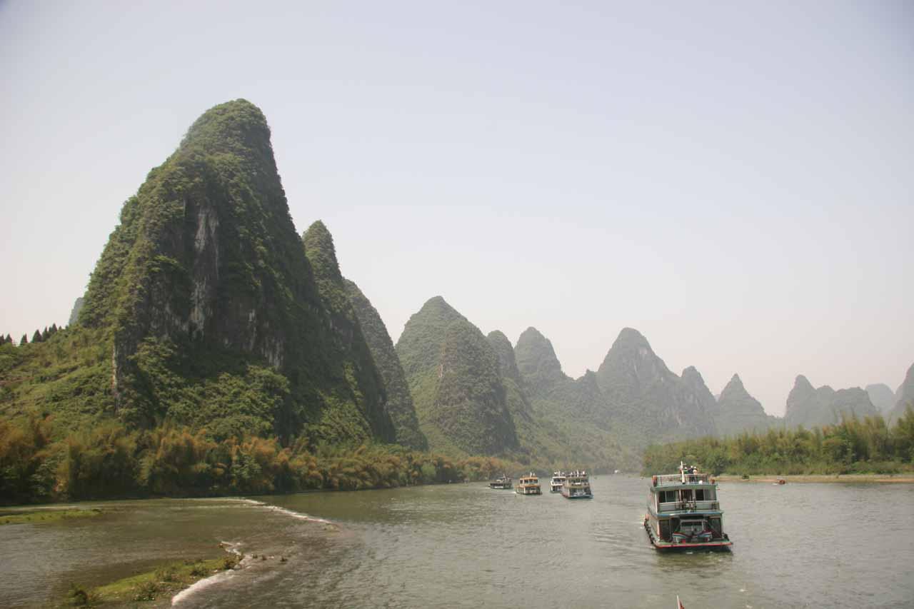 Looking back at boats along the Lijiang under stunning scenery