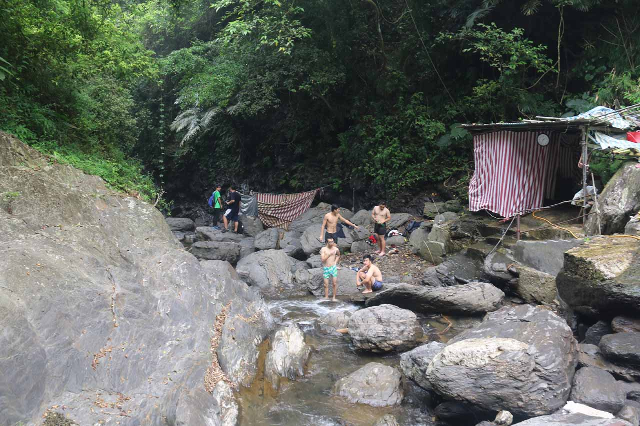 Around the second waterfall, there were sheds and more people keeping cool around the Niujiaowan Stream