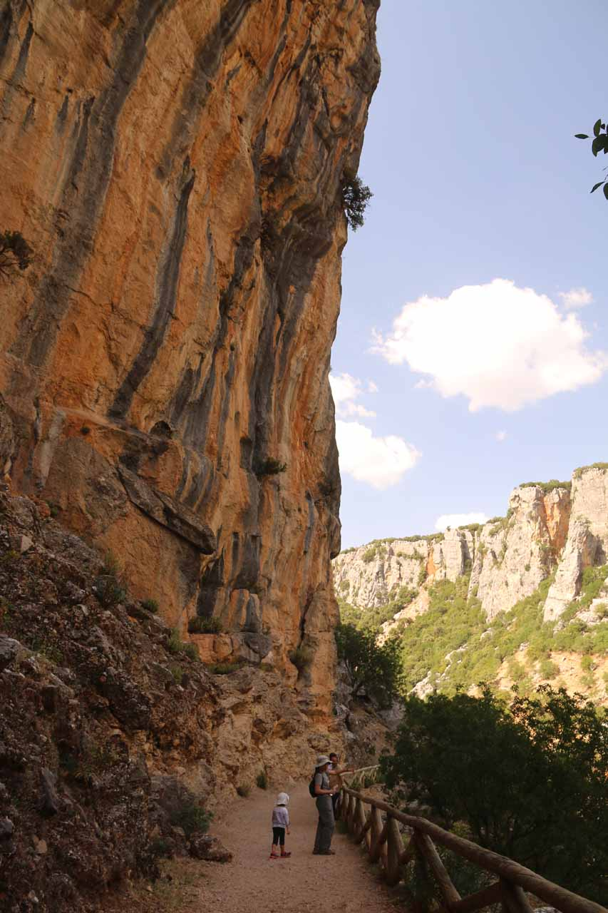 Tahia and Julie dwarfed by vertical cliffs near the Cascada de Linarejos
