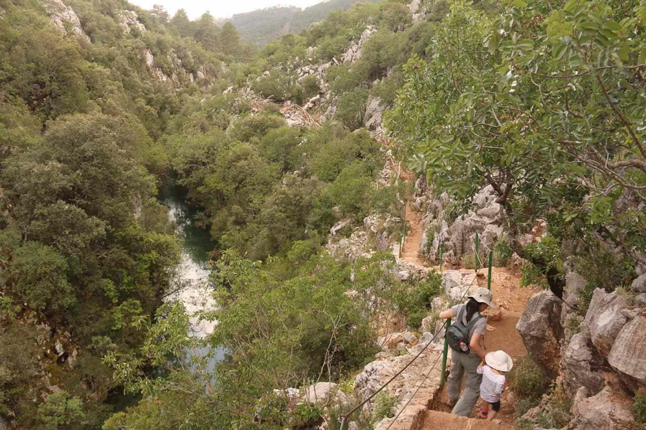 Julie and Tahia hiking alongside the gorge-hugging trail leading back to the trailhead