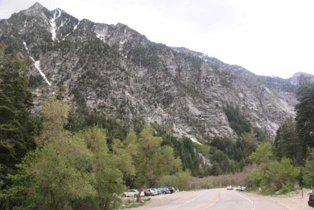 Lisa_Falls_001_05262017 - Looking back at a larger pullout alongside Little Cottonwood Canyon Road backed by some tall mountains as seen from the smaller pullout closer to the start of the short jaunt to Lisa Falls