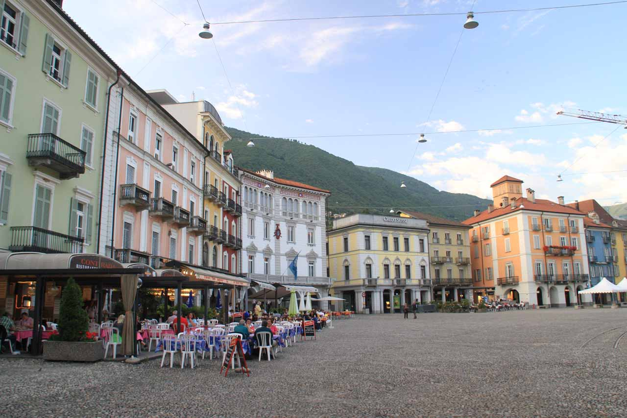In the wide open but dead Piazza Grande with its colorful buildings and cobblestone surfaces