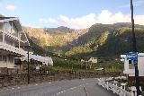 Lofthus_011_06232019 - Context of the Rv13 passing through Lofthus as I was headed south on it during my visit in late June 2019. As you can see, Skrikjofossen is easily seen in this direction