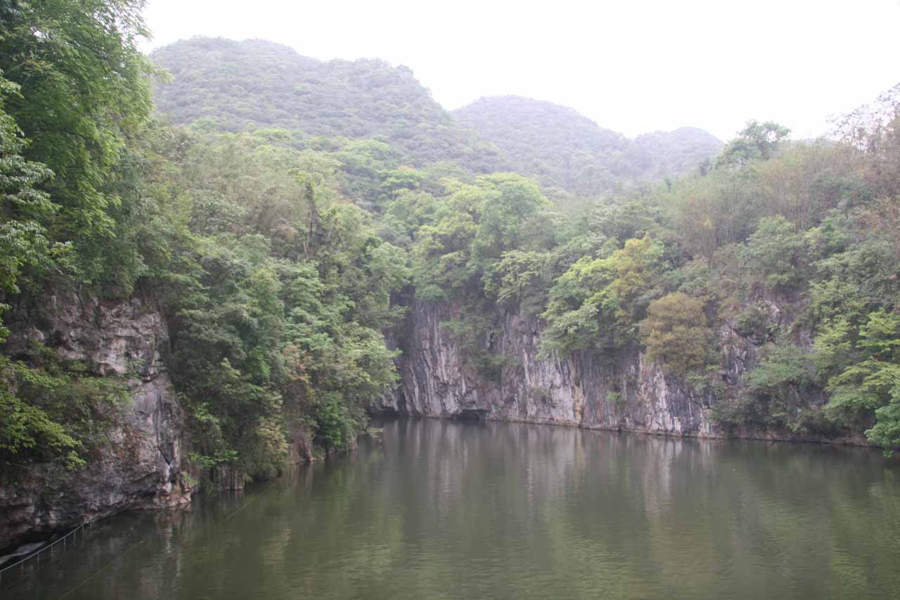 A serene lake atop the Longmen Waterfall