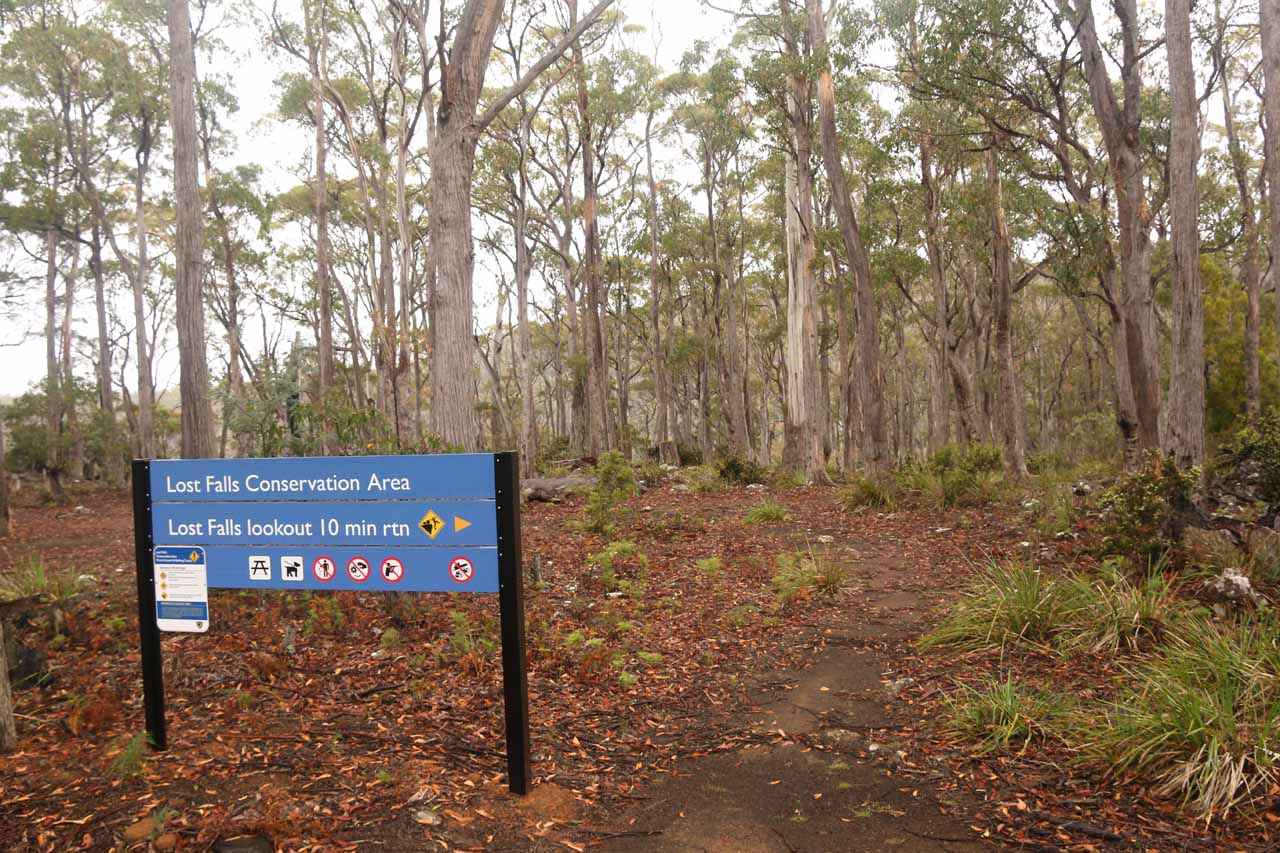 The signage at the trailhead, which was now blue and more modern looking instead of the old green sign that was here on our first visit