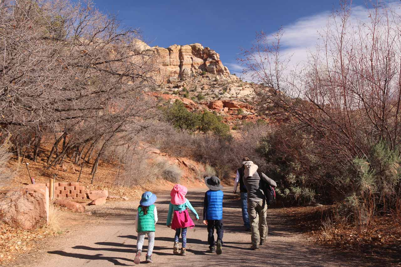 Julie and the kids walking the first 300 yards from the day use parking lot through parts of the campground, and then eventually to the trailhead register