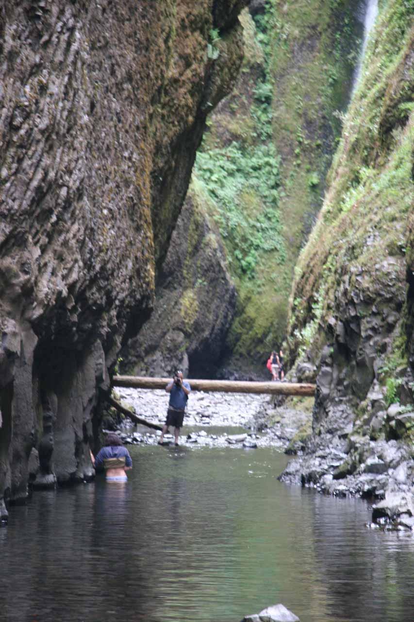 A couple slowly goes through waist-deep water