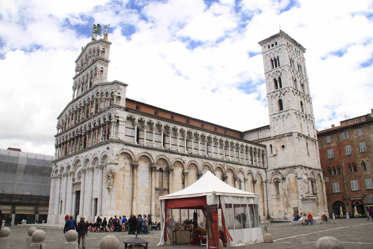 An attractive church and tower inside one of the piazzas of Lucca