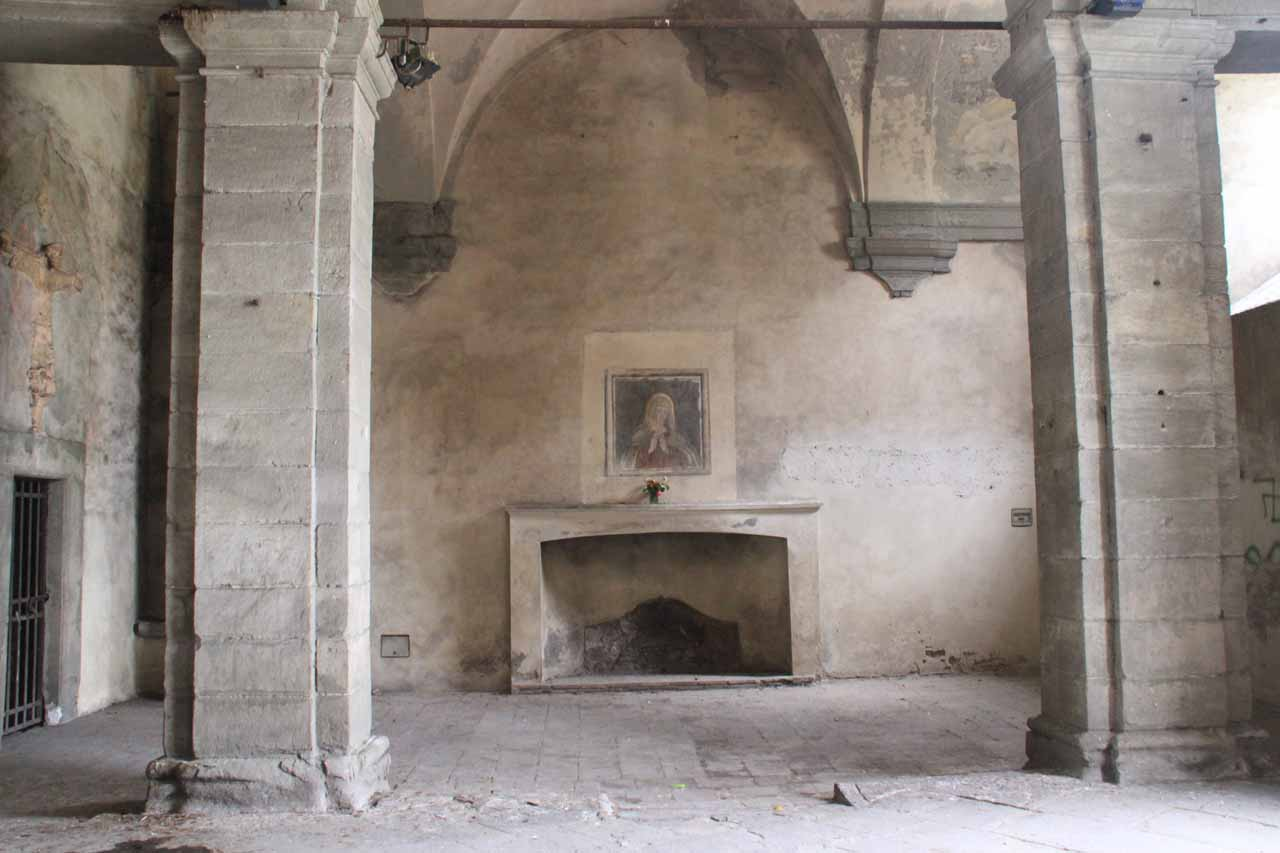 An old fireplace inside the Porta di San Donato