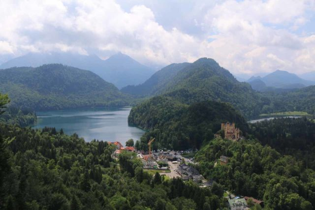 Ludwigs_Castles_346_06252018 - From the balcony on the west end of the Neuschwanstein Castle (after the guided tour ended), the weather finally started to clear and yield this incredible view of Schloss Hohenschwangau with Alpsee