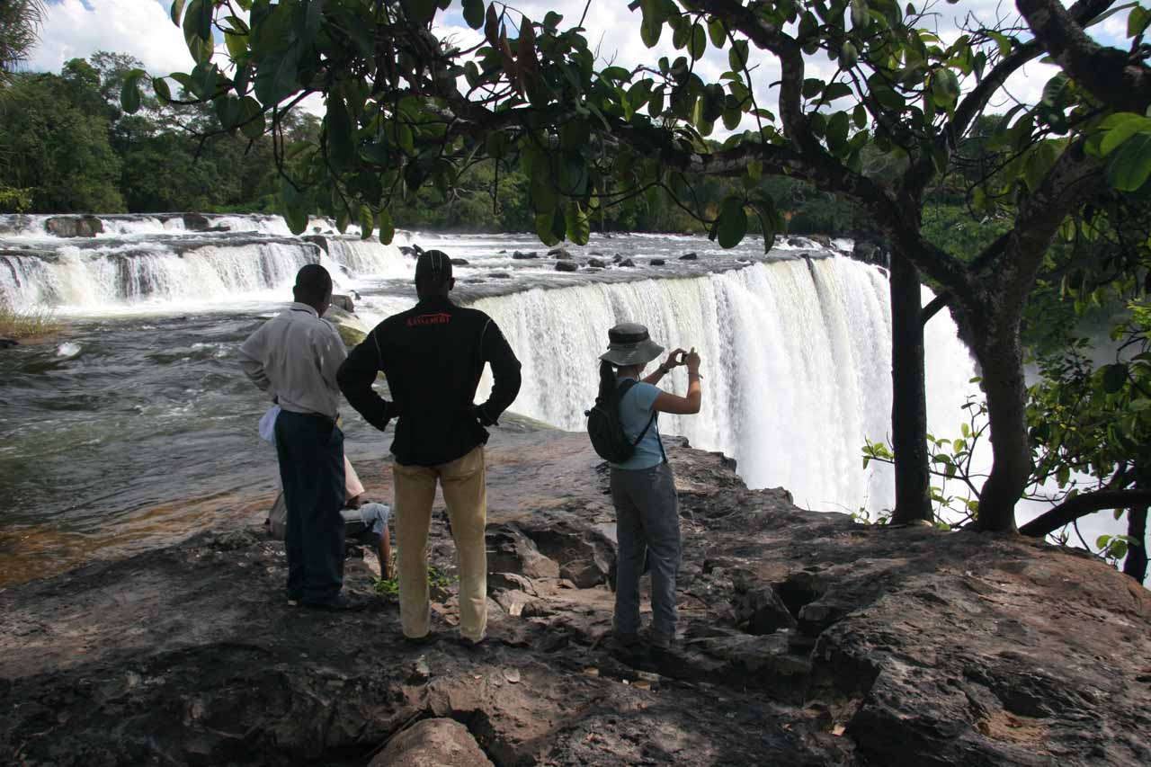 Joseph, Chanda, and Julie at the top of the falls
