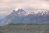 Lyngen_Alps_124_07042019 - Looking contextually towards the mountains and hidden waterfalls on the west side of Storfjorden from the Lyngen Channel ferry