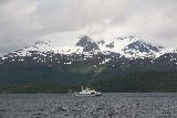 Lyngen_Alps_141_07042019 - Looking northwards from the ferry boat to Olderdalen as we noticed glaciers crowning the Lyngen Alps