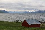 Lyngen_Alps_215_07042019 - Looking back towards the Lyngen Alps fronted by one of the scattering of farm buildings along the E6