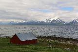 Lyngen_Alps_230_07042019 - Looking back across the Lyngen Channel with a red farm fronting the foreshore by the E6