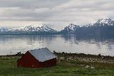 Lyngen_Alps_273_07072019 - Looking over a farm fronting the Lyngen Channel with parts of the Lyngen Alps in the background