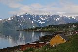 Lyngen_Alps_274_07072019 - Looking back in the direction of Djupavik and some farms with the Lyngen Alps looming in the distance