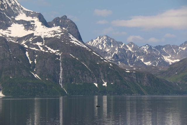 Generally in landscape photos, we want a greater depth of field so everything in the photo is sharp and in focus like in this picture of the Lyngen Alps