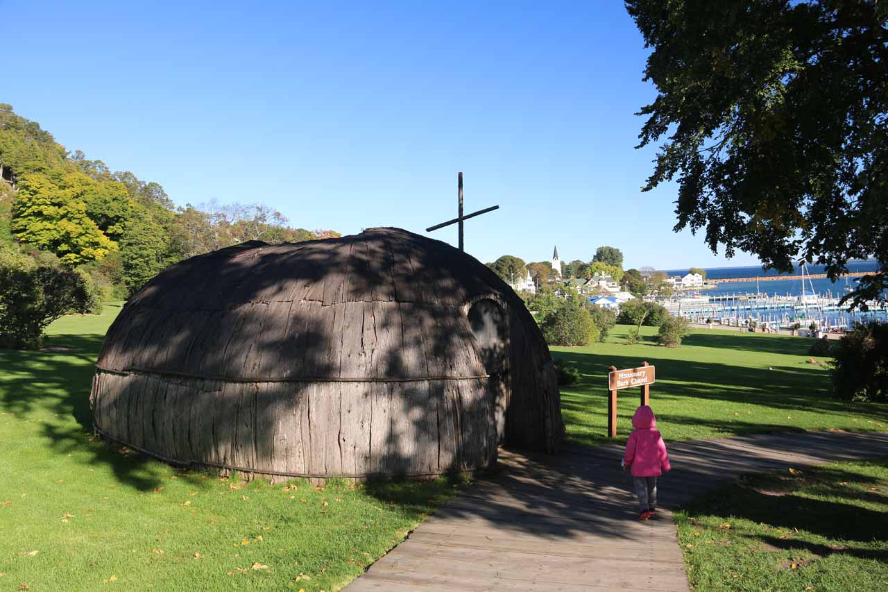 Tahia checking out some round hut structure on Mackinac Island