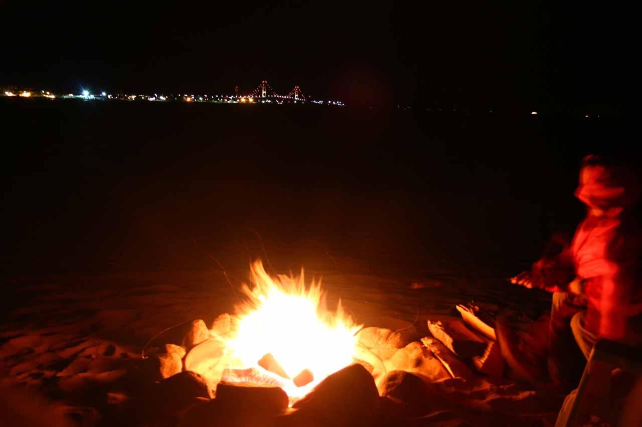 Enjoying roasting smores over a beach pit bonfire from the Clearwater Lakefront Motel